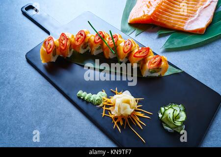 Rice Maki Sushi with salmon chili asparagus and cheese cream. - Stock Photo