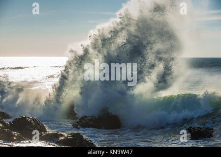Spectacular wave crashing into rocks of Atlantic Ocean shore in Nevogilde civil parish of Porto, second largest - Stock Photo