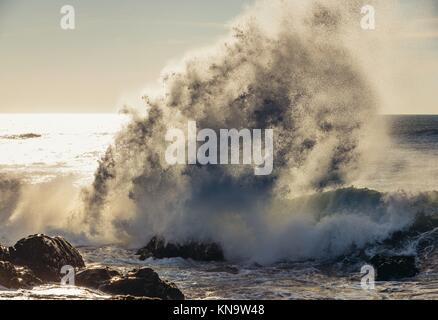 Spectacular wave crashing into rocks of Atlantic Ocean shore in Nevogilde civil parish of Porto, second largest - Stock Photo