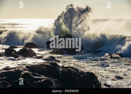 Big waves smashing on rocks of Atlantic Ocean shore in Nevogilde civil parish of Porto, second largest city in Portugal. - Stock Photo