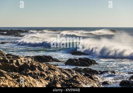 Atlantic Ocean waves seen from shore of Nevogilde civil Parish of Porto city, second largest city in Portugal. - Stock Photo