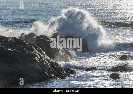 Waves crashing on rocks of Atlantic Ocean shore, view from Molhe beach in Nevogilde civil parish of Porto, second - Stock Photo