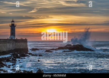 Sunset over Atlantic Ocean. View with Felgueiras Lighthouse in Foz do Douro district of Porto city, second largest - Stock Photo