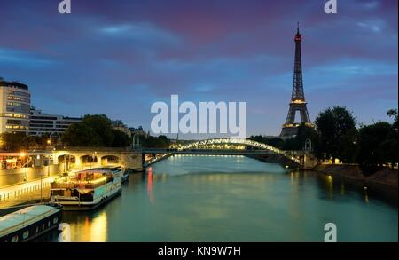 Cityscape of Paris with the view on Eiffel Tower and Pont Rouelle in early morning, France. - Stock Photo