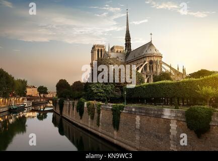 Sunset over Notre Dame de Paris, France. - Stock Photo