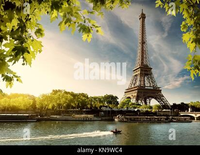 Sunset over Paris with the view on Eiffel Tower and river Seine, France. - Stock Photo