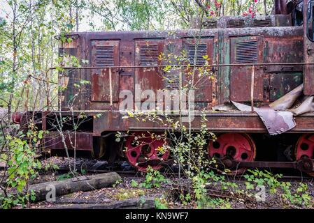 Old Soviet engine near Prypiat city and Yaniv railway station in Chernobyl Nuclear Power Plant Zone of Alienation - Stock Photo