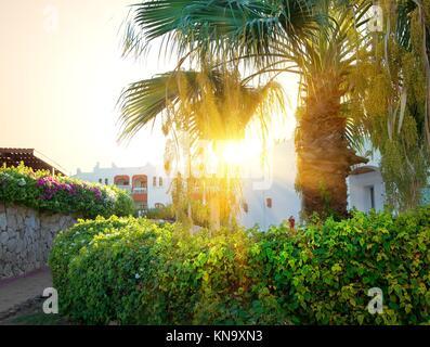 Bright sunrise over resort hotel in Egypt. - Stock Photo