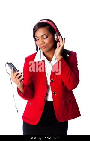 Beautiful happy business woman jamming listening to music on wireless mobile phone, on white.