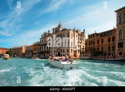 Warm summer day in romantic Venice, Italy. View from the bridge of Academia. - Stock Photo