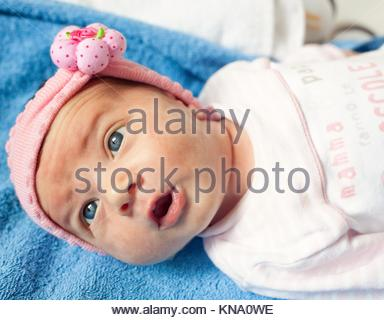 Portrait of a newborn Baby Girl with blue eyes. - Stock Photo