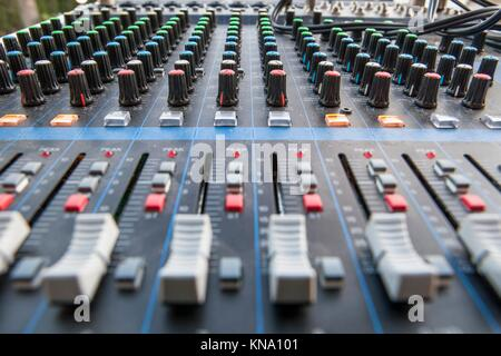 Sound board closeup for outside live performance. Selective focus. - Stock Photo