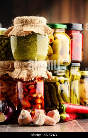 Jars with variety of pickled vegetables. Preserved food. - Stock Photo