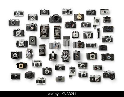 Collection of old analog different camera's on white background. - Stock Photo