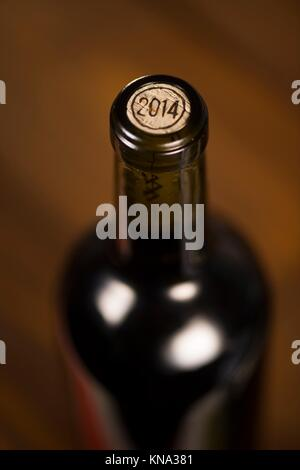 Close-up of closed wine bottles lying on blurry background, winery. - Stock Photo