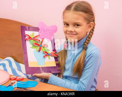 The girl made a birthday card for mom on Mothers Day. - Stock Photo