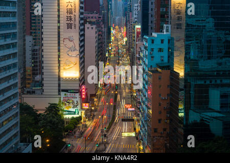 Traffic in a busy street in Hong Kong - Stock Photo