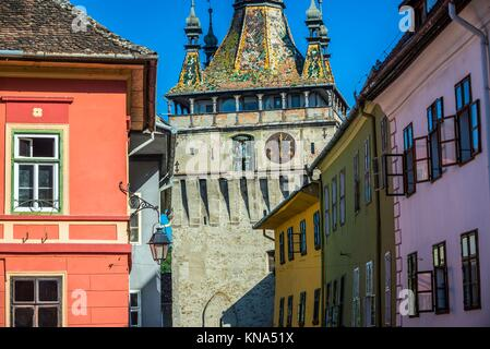 Famous Clock Tower in Sighisoara town in Romania. - Stock Photo