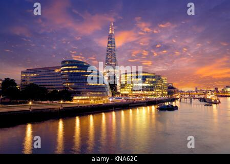 London skyline sunset City Hall and Shard on Thames river. - Stock Photo