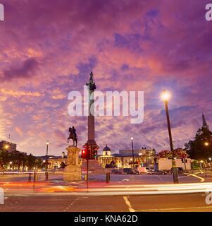 London Trafalgar Square sunset Nelson column in England. - Stock Photo