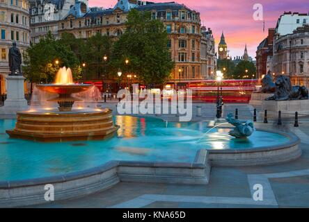 London Trafalgar Square fountain at sunset England. - Stock Photo