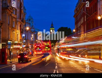 London Big Ben from Trafalgar Square traffic lights at sunset. - Stock Photo