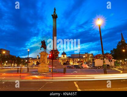 London Trafalgar Square sunset Nelson column in England. - Stock Photo