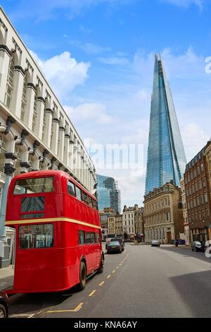 The Shard and old London red Bus in England. - Stock Photo