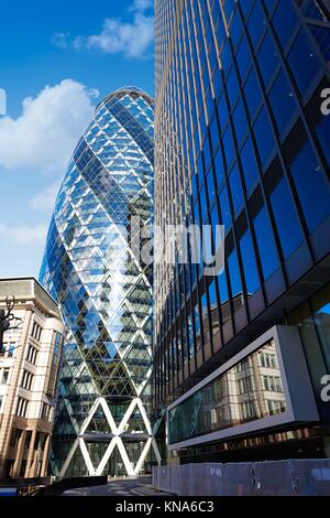 London financial district street Square Mile with Gherkin building. - Stock Photo