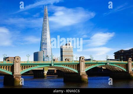London Southwark bridge and the Shard on Thames river in UK. - Stock Photo