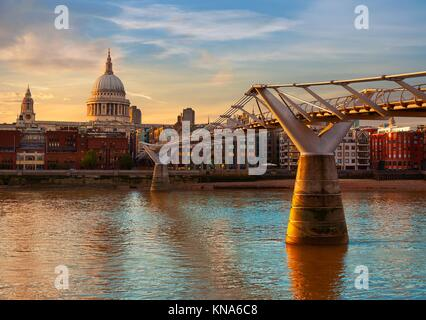 London St Paul Pauls cathedral sunset from Millennium bridge on Thames UK. - Stock Photo