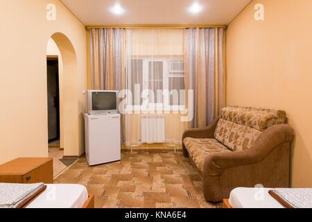 Living room interior sofa fridge table door clock in - The living room mumbai maharashtra ...