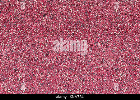 Texture of bituminous coating for the facade of the house. Seamless texture of burgundy color. Can be used in interior design, in architectural design