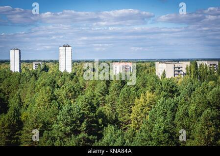Aerial view of Pripyat ghost town in Chernobyl Nuclear Power Plant Zone of Alienation around the nuclear reactor - Stock Photo