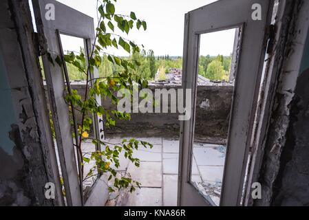 Polissya Hotel in Pripyat ghost city of Chernobyl Nuclear Power Plant Zone of Alienation around nuclear reactor - Stock Photo