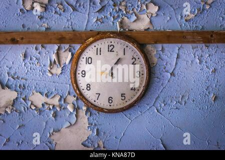 Clock in High school No 3 in Pripyat ghost city of Chernobyl Nuclear Power Plant Zone of Alienation around nuclear - Stock Photo