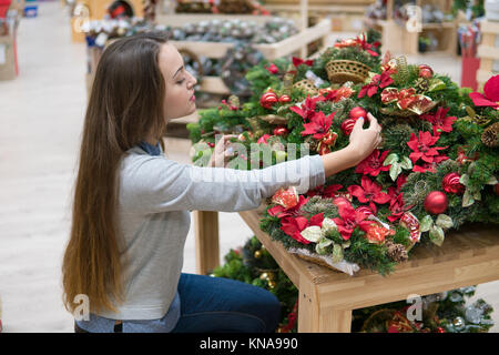 customer woman choosing Christmas decorations - Stock Photo