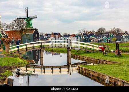 Wooden Windmill White Bridge Reflection Zaanse Schans Old Windmill Village Countryside Holland Netherlands. Working - Stock Photo