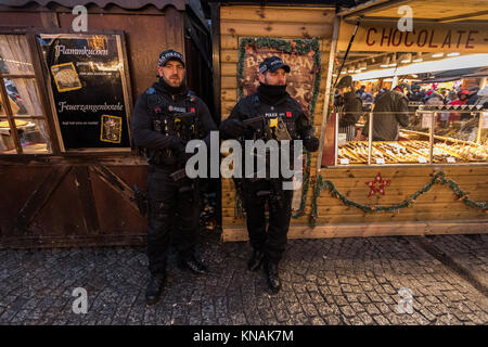 Armed Police Officers On Duty And On Patrol  At Manchester Christmas Markets Around The City, Manchester, England, - Stock Photo