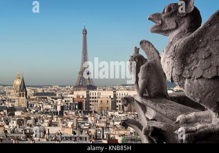 Eiffel Tower and Chimeras looking on Paris, France. - Stock Photo