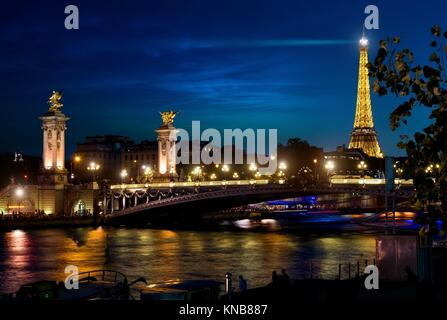 View on Eiffel Tower and Bridge of Alexander in night Paris, France. - Stock Photo
