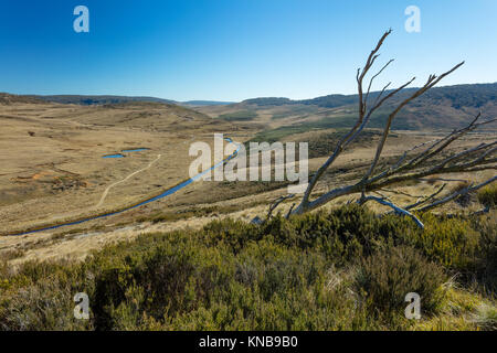 View over the Eucumbene River towards Kiandra in Kosciuszko National Park in the Snowy Mountains of New South Wales. - Stock Photo