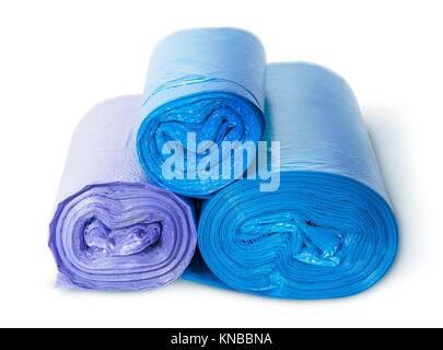 Three rolls of plastic garbage bags isolated on white background. - Stock Photo
