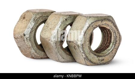 Three old rusty nuts in a row rotated isolated on white background. - Stock Photo