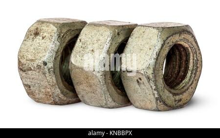 Three old rusty nuts in a row isolated on white background. - Stock Photo