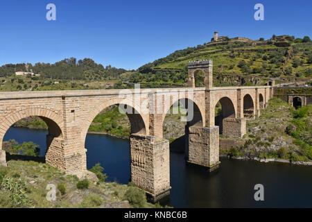Roman bridge over the Tajo river in Alcantara, Caceres province, Extremadura, Spain. - Stock Photo