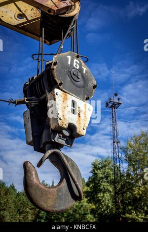 Lifting hook of railroad crane in abandoned Yaniv town railway station, Chernobyl Nuclear Power Plant Zone of Alienation - Stock Photo