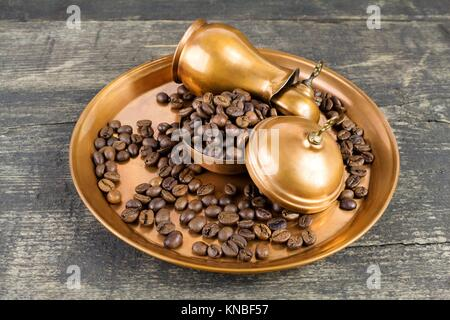 Turkish coffee with traditional copper serving set and coffee beans. - Stock Photo