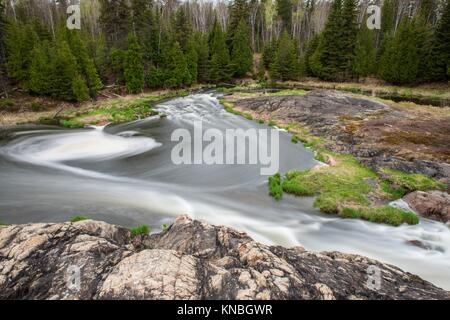 Junction Creek rapids in early spring, Greater Sudbury, Ontario, Canada. - Stock Photo