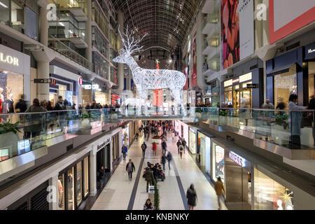 Toronto Eaton Centre Christmas decoration, an illuminated reindeer, inside the shopping mall, downtown Toronto, Canada.